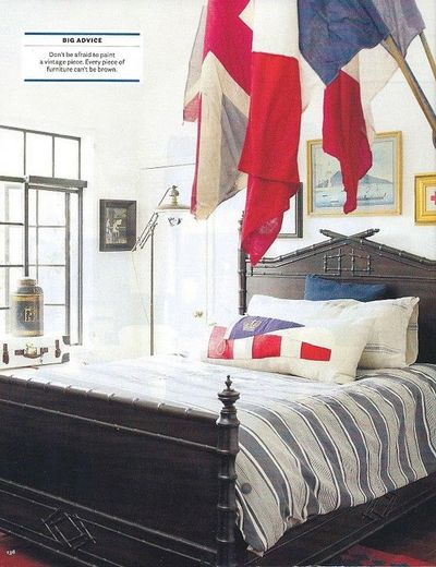 Red, white, and blue bedroom by Dan Marty Design (from House Beautiful). Antique ticking bed cover and flags.