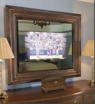 tv concealed behind 2 way glass frame mirror when the tv