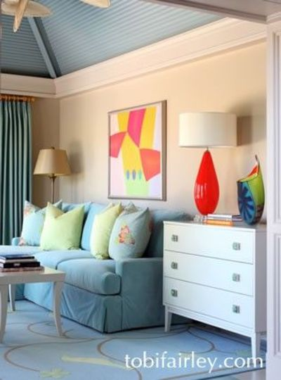 Serene sun room with bold pops of bright color Design: Tobi Fairley