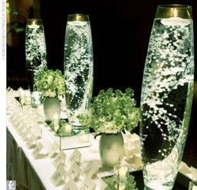 Babys Breath Submerged In Tall Vases Of Water With A F