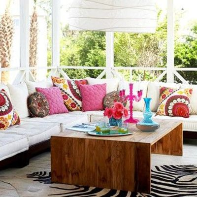 bohemian casual patio. love the natural wood coffee table an