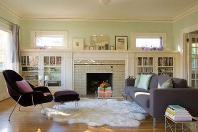 Built In Cabinets With Gl Doors Flanking Fireplace