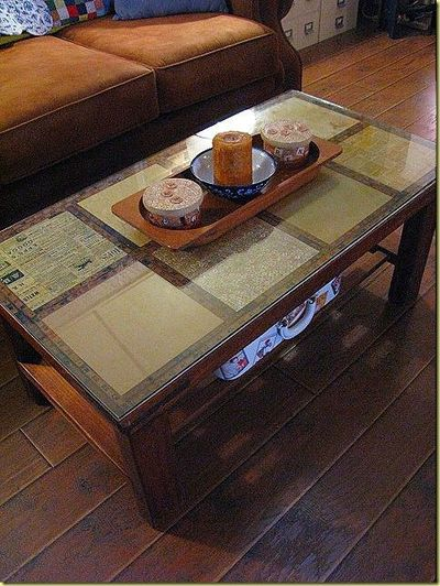 decoupage a coffee table using scrapbook paper then us