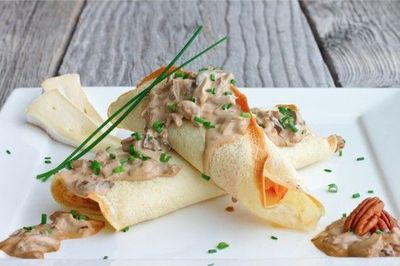 Delicious Savory Crepes Stuffed with Brie, Ham and Asparagus, topped with a Creamy Mushroom Sauce = Heaven!