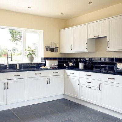 White Cabinets, Black Counter   Would Definitely NOT Do Tan Walls Though