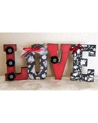 Wooden letters covered with designer paper