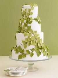 A Green Garden Wedding Cake  Green fondant-made leaves and soft branches put a twist on a simple white wedding cake.
