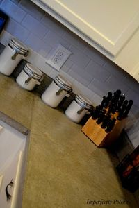 Concrete counters with subway tile.