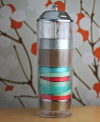 Straw dispenser ribbon storage. Great for those extra gorgeous spools.