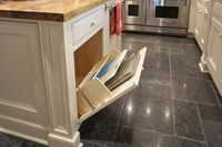 to hold cutting boards and cookie trays.