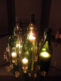 Wine bottles and candles centerpiece. Especially nice for outdoors!