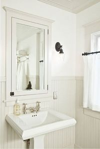 Classic white bath with recessed cabinet