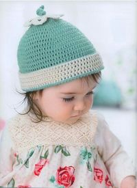 Love this hat and the flower with the i-cord knot at the top