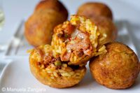 Arancine: My family recipe for a very popular Sicilian street food: arancine - fried balls of saffron rice fil...[read more at Food Frenzy]