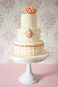 Victorian inspired wedding cake - peach, ivory and gold cake with cameo.
