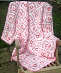 Granny Square Afghan in pink and white.