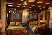 bedroom in the cinderella suite in the castle at disney world. would love to stay in it but will never will. Not a chosen one to stay.