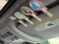 For parents or grandparents -Road trip clips: One clip for each kid.... If they are sweet, clip stays up, if they are not, clip comes down. Everyone with a clip on the visor gets a treat at the next stop :-) love this idea!!!