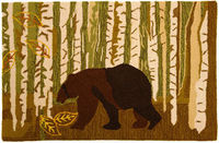 The Birch & Bear Rug features the silhouette of a bear standing in the center of the forest. The rug also details a birch forest in earth tones that is accented by falling leaves.