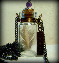 Glass Vial Necklace Glass Bottle Necklace Stamped Believe with Feather Antique Brass and copper - 30 inches long from etsy.com