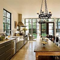 custom-made wood windows painted dark brown-green -- interior by Rozanne Jackson Interiors