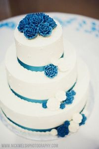 White wedding cake with blue accents. www.nickwelshphotography.com