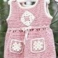 Use this easy crochet pattern to make a cute outfit for your little girl. She'll look so adorable in this jumper that has granny pockets for all her findings. Serenity sport weight yarn is used.