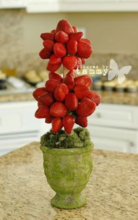 Strawberry Topiary. I can see this at a reception. Maybe even with the berries dipped in chocolate or white chocolate drizzles.