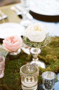 Love the moss, the silver and the pale pastel roses