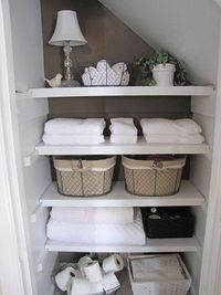 This photo inspired me to clean out my hall closet. I found the baskets at Tuesday Mornings in California.
